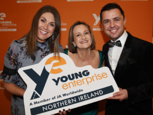 Young Enterprise NI CEO Carol Fitzsimons MBE with hosts Pete Snodden & Sarah Travers